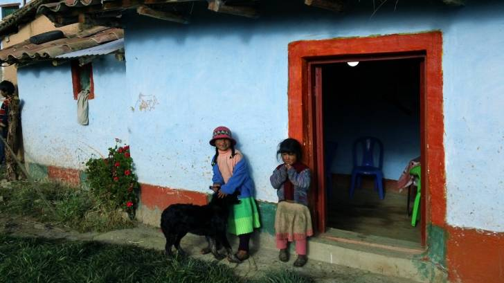 bolivian children in a doorway