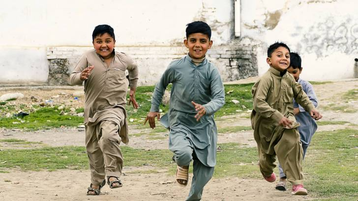 children running, laughing
