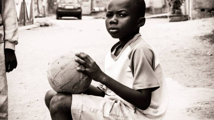 young african child with a basket ball