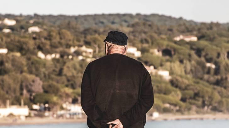older man contemplating