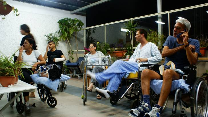 people in hospital, wheel chairs, smokinig