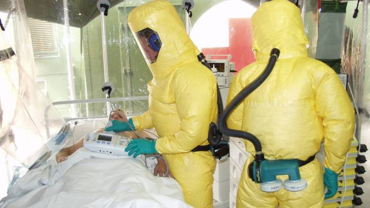ebola isolation tent with patient and care givers