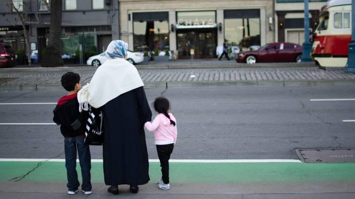 migrant family on street