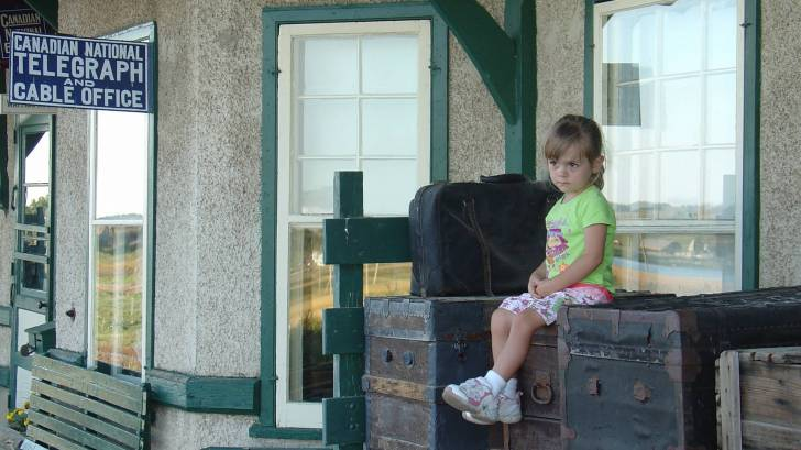 young girl at a train station
