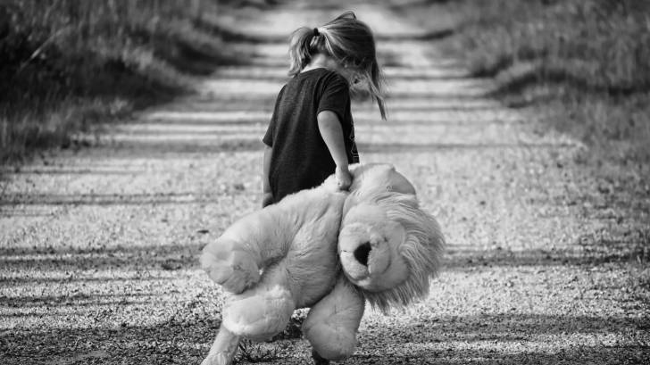 girl walkng teddy bear
