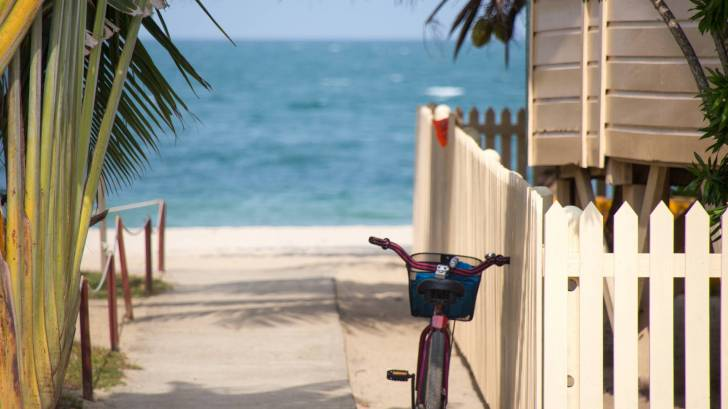 bike resting next to a beach house in the florida keys