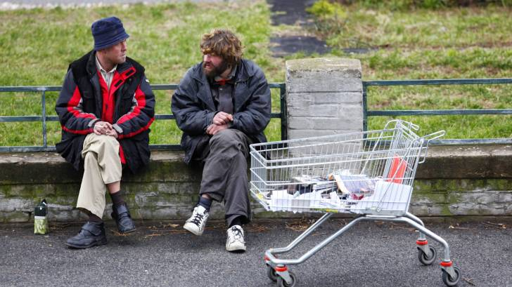homeless people on a bench