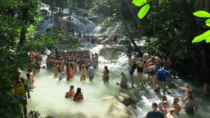 jamaican water fall and tourists