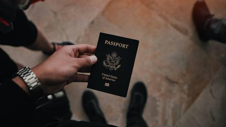 us passport in travelers hand