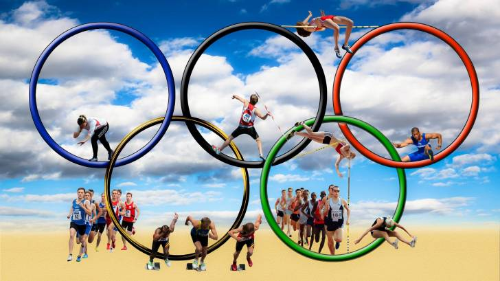 olympic rings and athletes