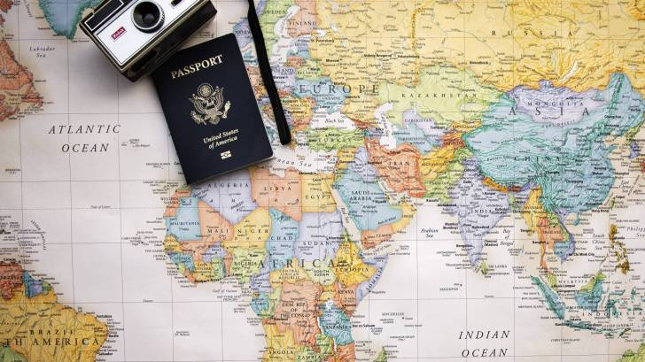 passport old time camera and world map