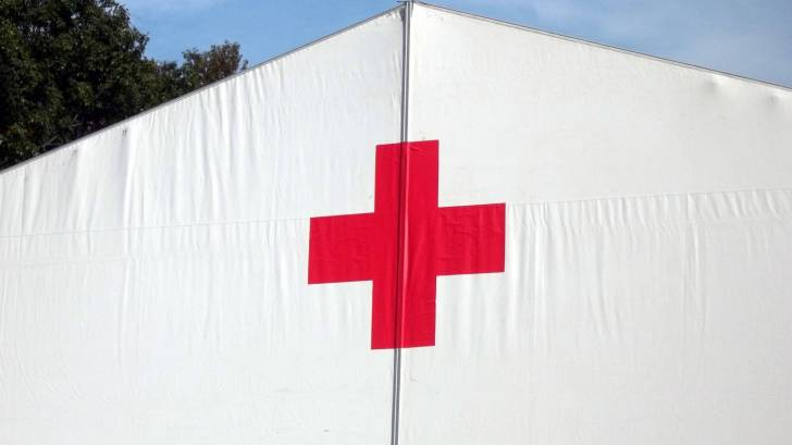 red cross tent to help