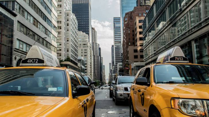 nyc taxi cabs on busy street