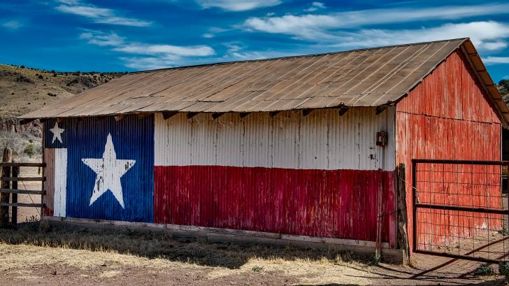 texas flag painted on the side of a barn