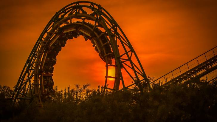 roller coaster at sunset