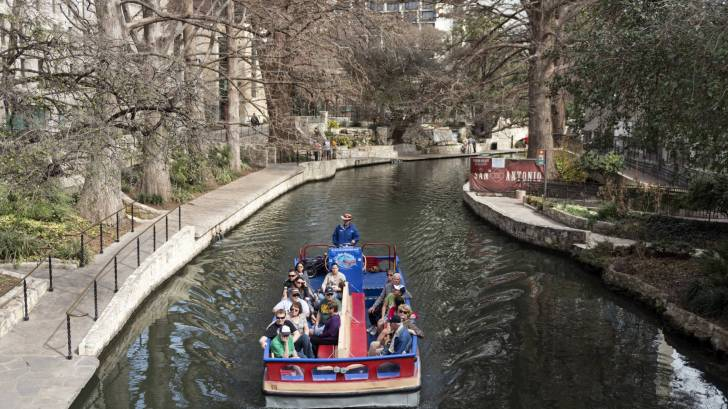 river walk in san antonio with a tourist barge