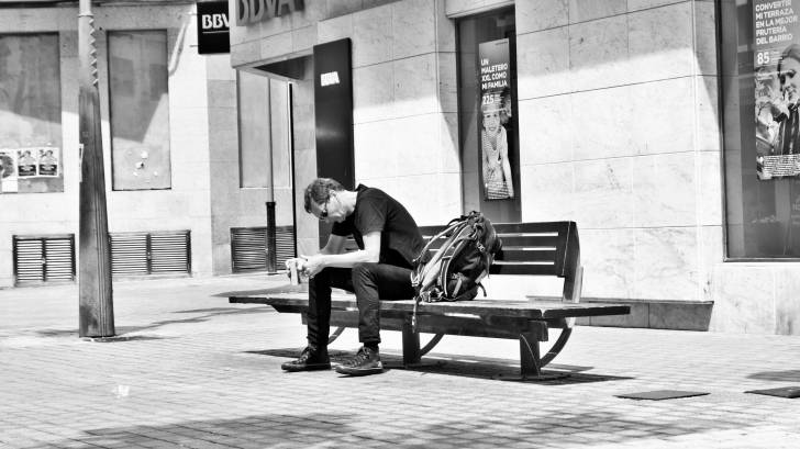 traveler taking a rest on a park bench
