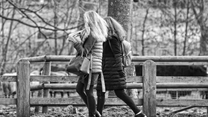 two women walking outdoors