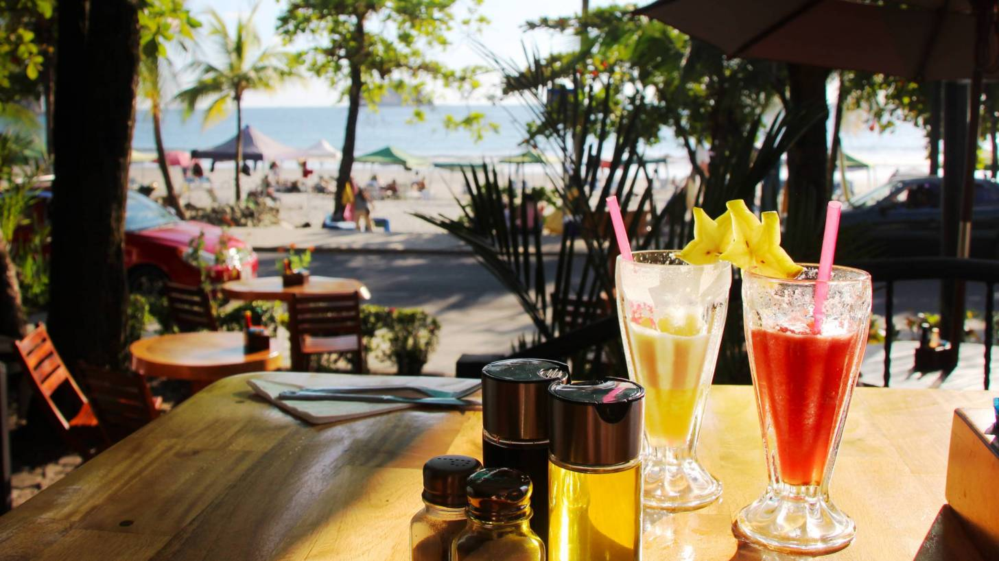 restaurant by the beach, showing two fruit cocktails