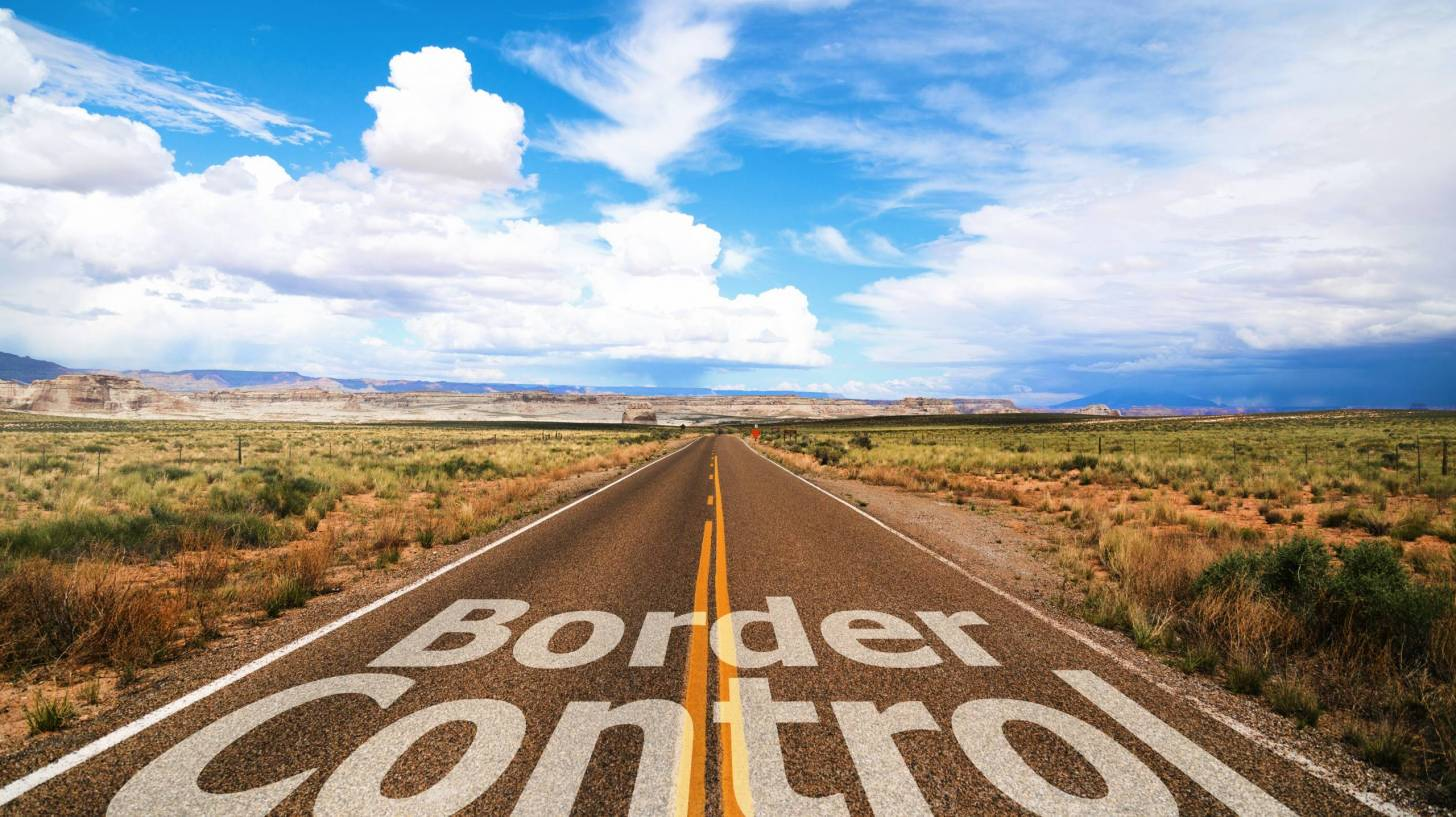 border control sign on the road