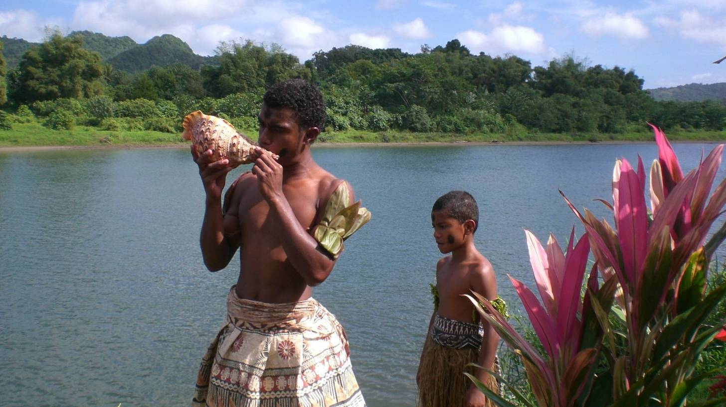 fiji island and natives on the water way