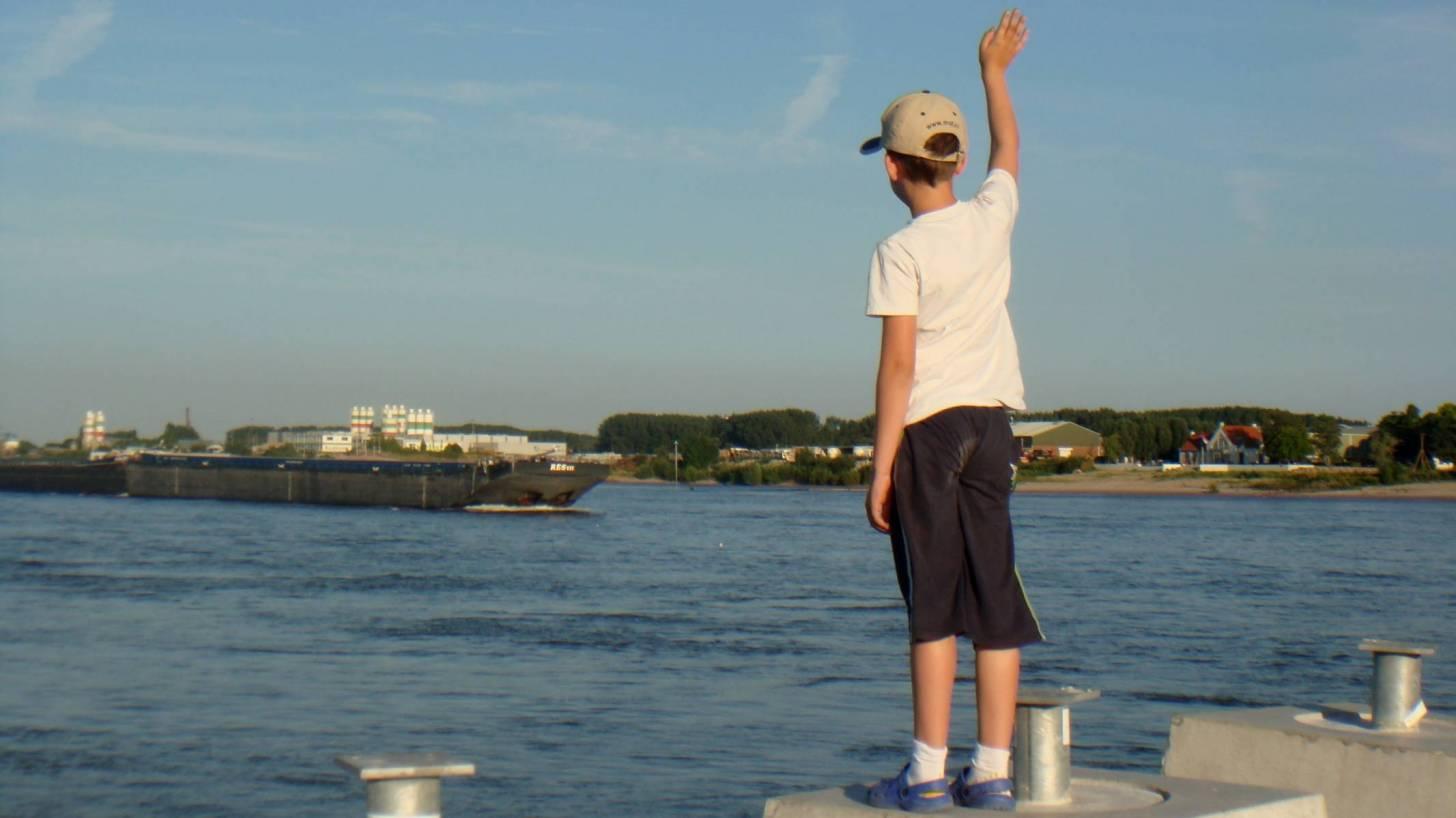 boy waving good bye