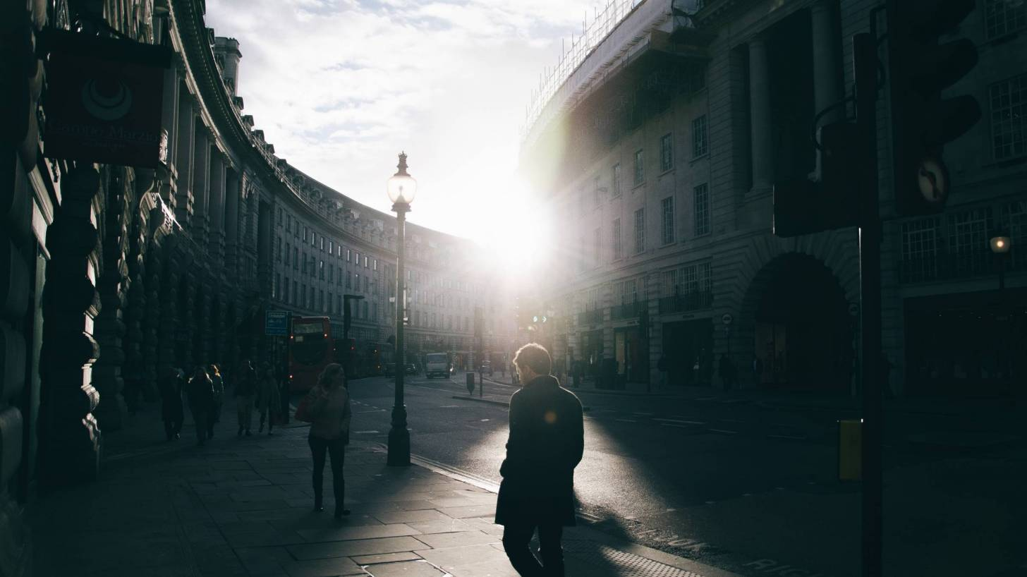 london street with sun peeking out