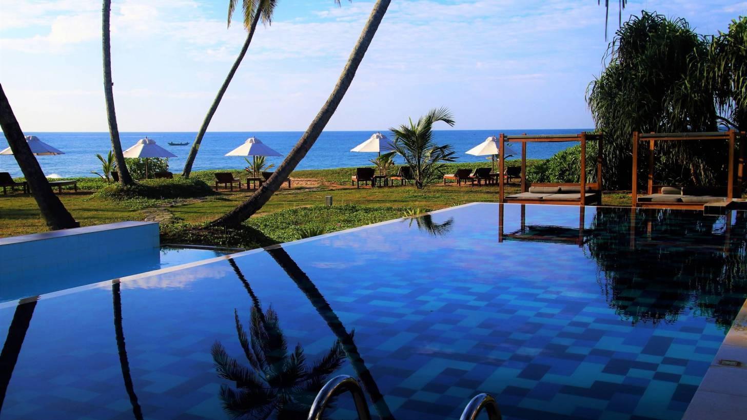 resort pool overlooking the ocean in sri lanka