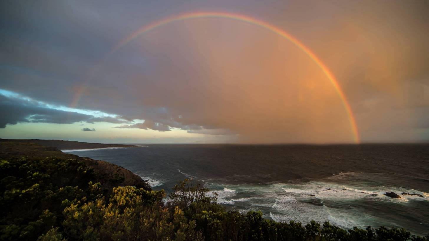 rainbow over the australian ocean