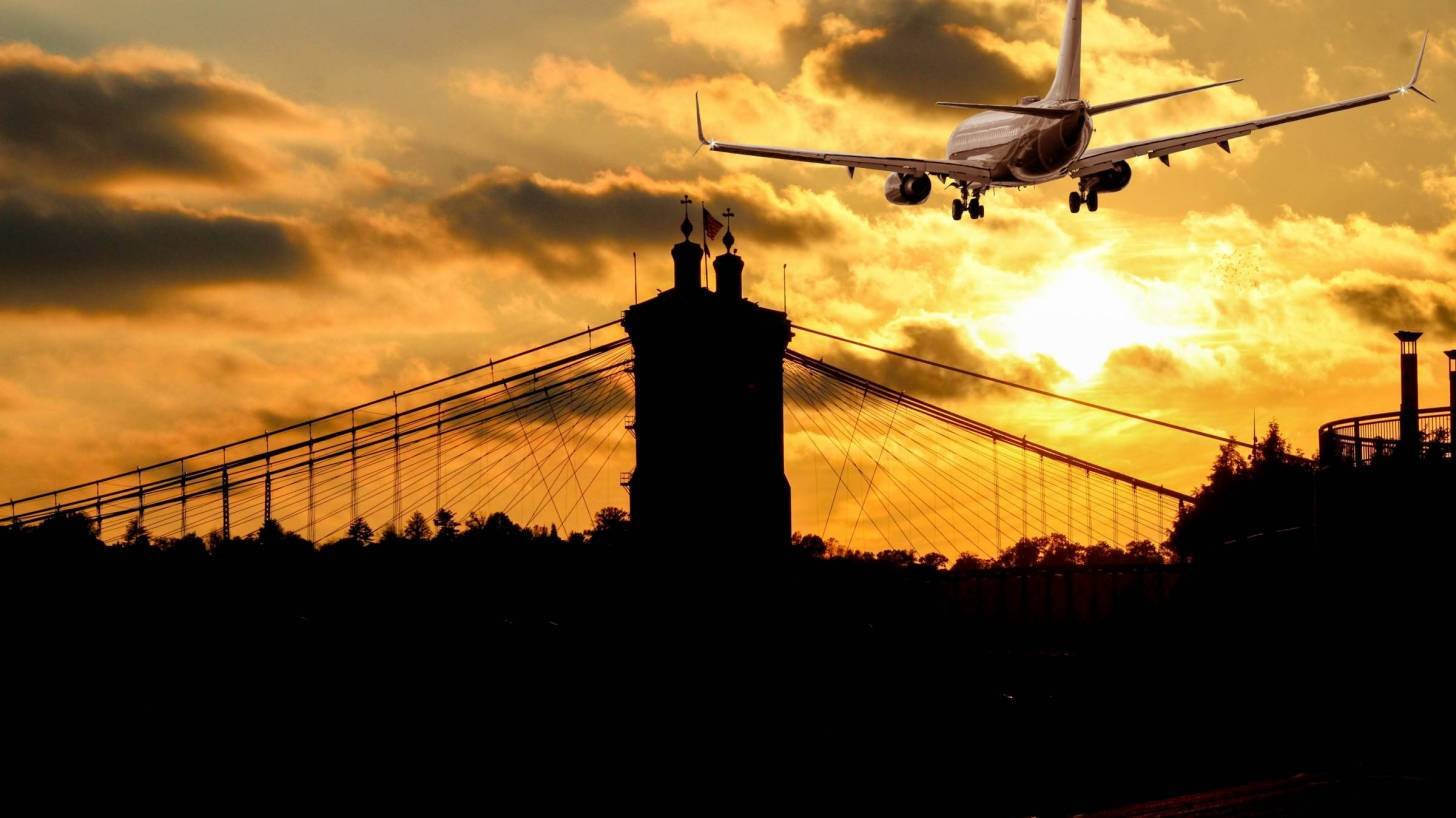 sihouette of plane landing