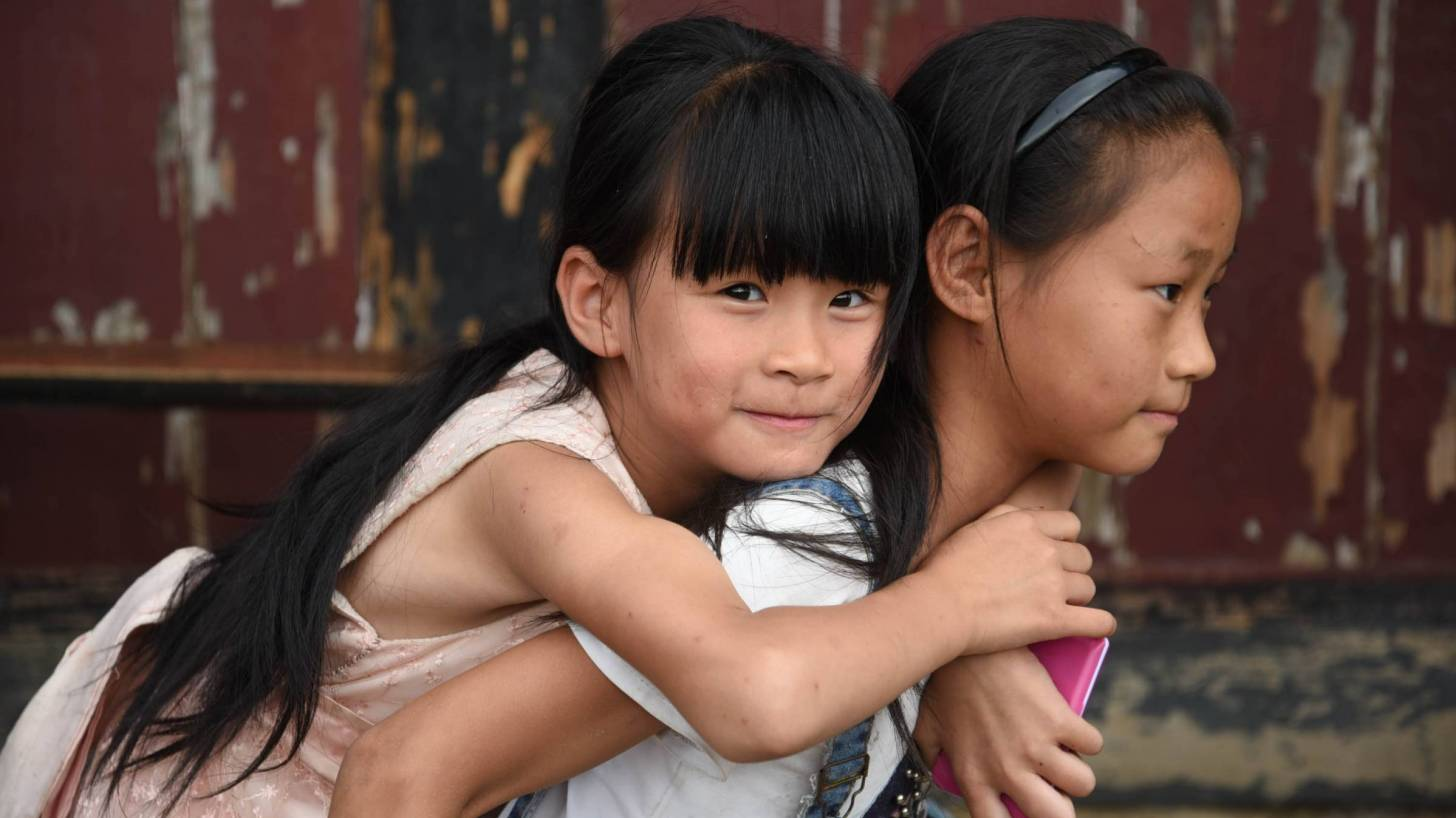 young chinese sisters having fun