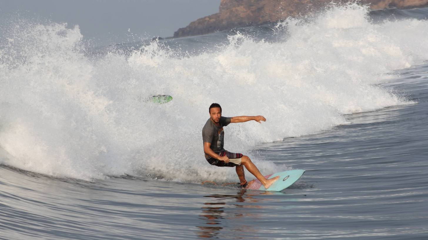 surfer riding the waves freely