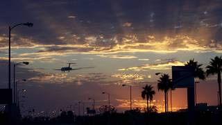 international jet landing at lax at sundown