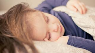 young child in bed sick