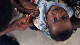 young african boy getting a vaccination