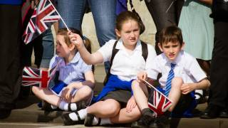 young kids watching a parade in the UK