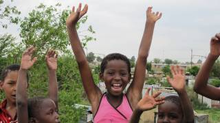 children happy smiling raising hands