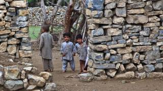 poor children in dirt home, unsanitary conditions