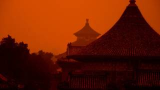 red sky chinese buildings