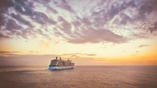 cruise liner at open sea at sunset