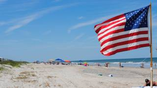 july 4th on the beach with american flag