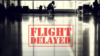 airport with sign saying flight delayed