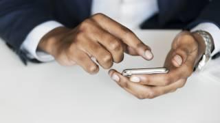 cell phone, someone tweeting