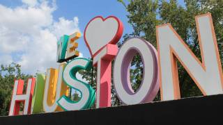 we love houston sign in bright colors and large letters