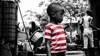 young african boy in red striped shirt