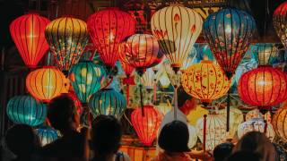 chinese paper lanterns lit in the sky