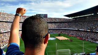 man cheering at the barcelona football stadium