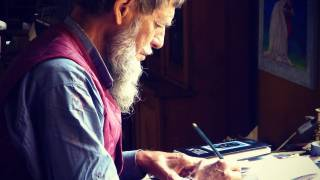 older man drawing a picture