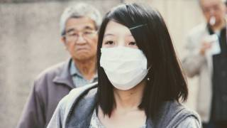 asian girl with a mask protecting her