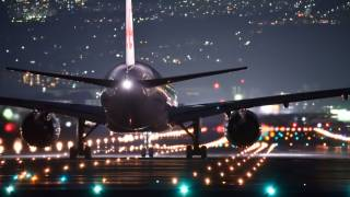 plane landing in the night time lights